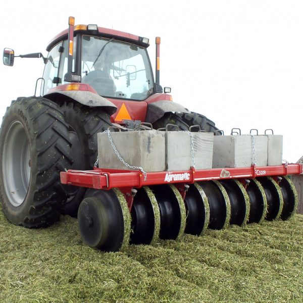 Farmer packing silage with Agromatic Big Foot Silage Packer.