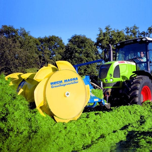 Farmer spreading silage with Agromatic RECK Magna Silage Spreader.