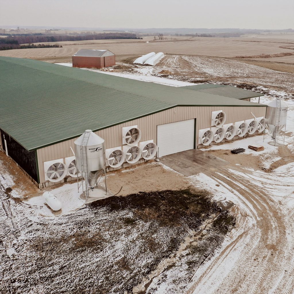 Aerial view of dairy barn with direct drive exhaust fans.