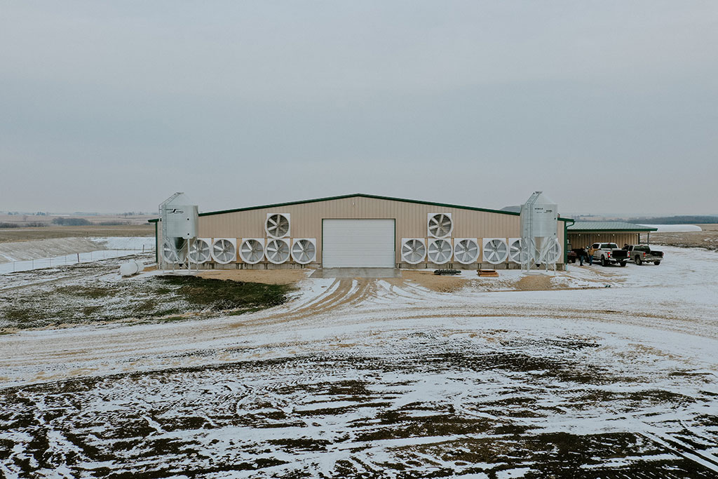 Modern dairy farm in the Wisconsin Winter with barn ventilation (outside view).