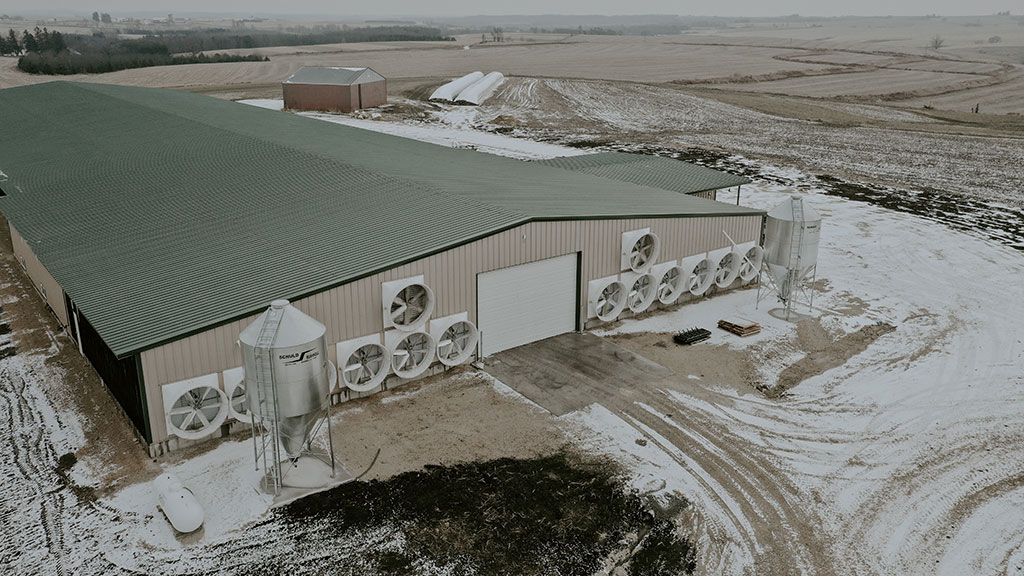 Overhead view of a modern dairy farm with barn ventilation.