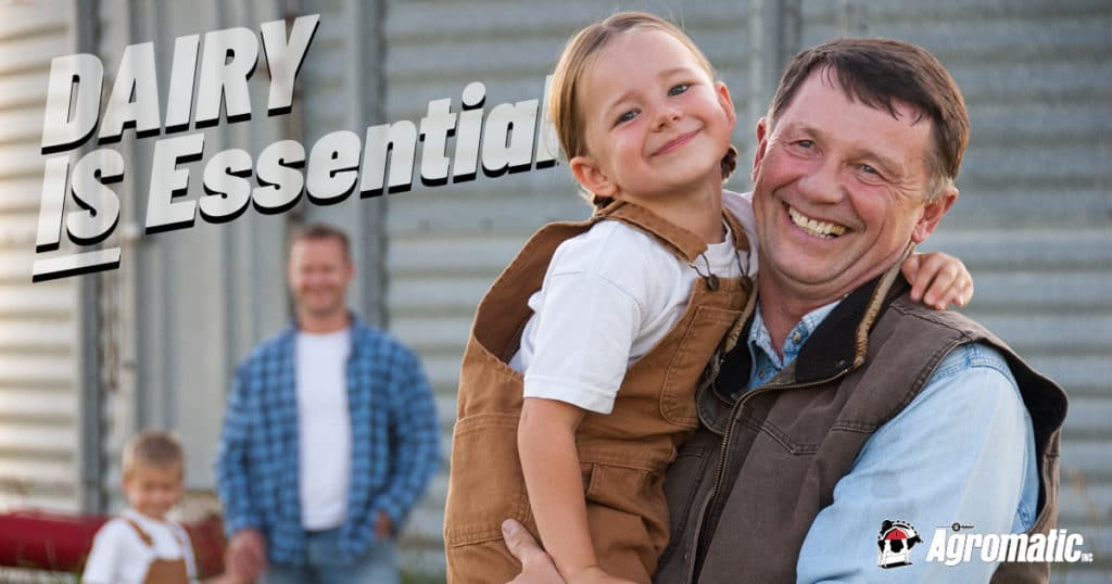DAIRY IS Essential: Grandfather with granddaughter on farm.