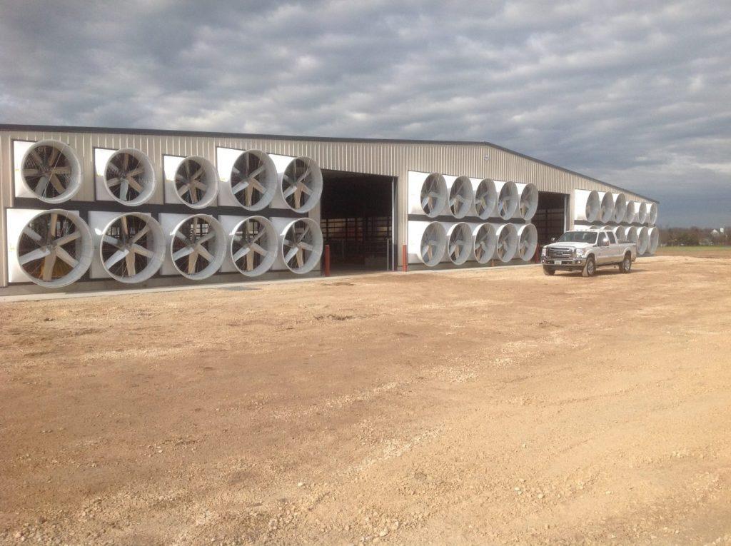 Tunnel ventilation on a beige cow barn.