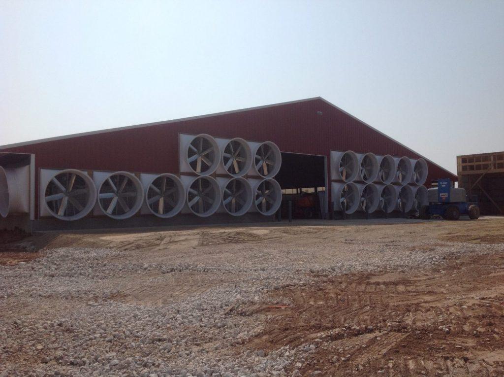 New red barn fans. Exhaust fans on external walls.