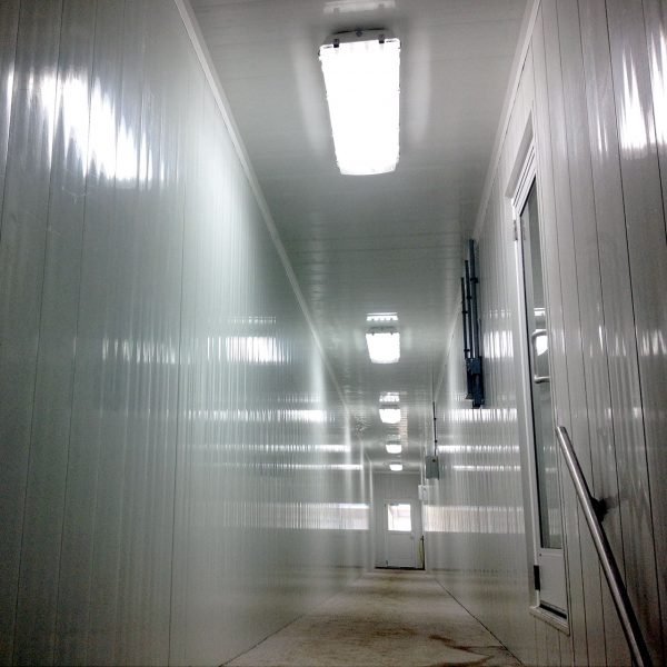Hallway to milking parlor lined with Agromatic wall panels