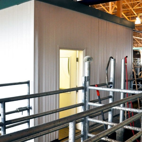 Agromatic concrete wall forms in robotic milking parlor