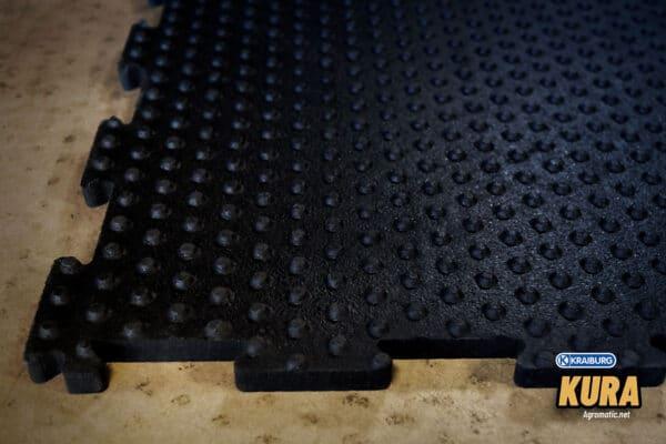 KRAIBURG KURA interlocking cow mat underside and puzzled edges view.